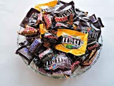 m and m on clear cut glass bowl